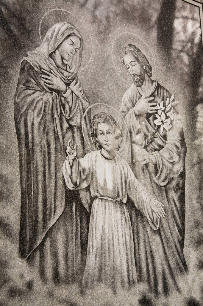 Religious figures depicted on a memorial monument in a cemetery, montreal quebec canada : Stock Photo
