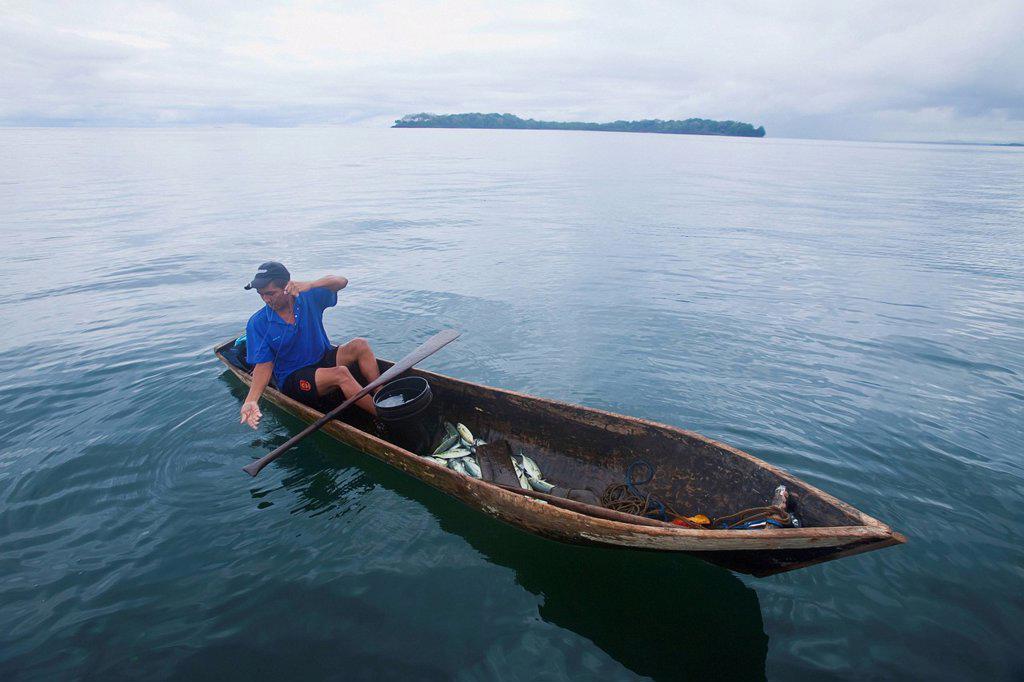 Man fishing in canoe type dugout boat, panama : Stock Photo