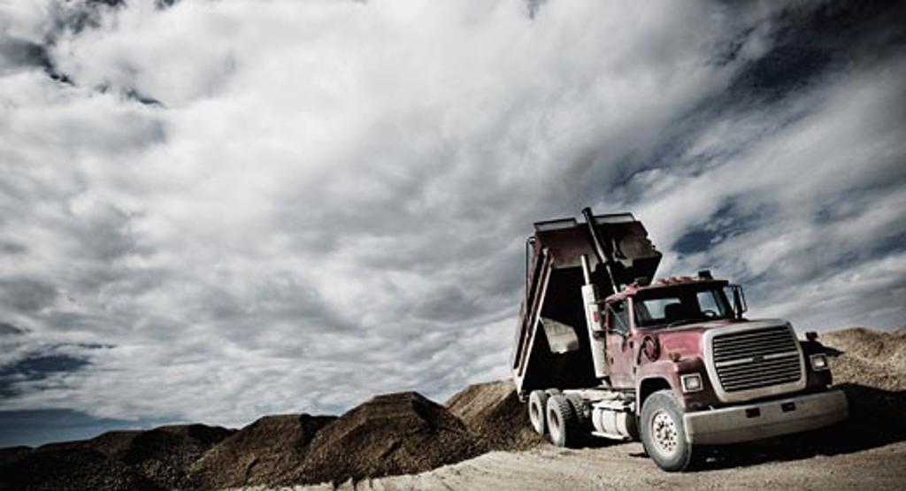 Stock Photo: 1889R-10048 Dump truck unloading