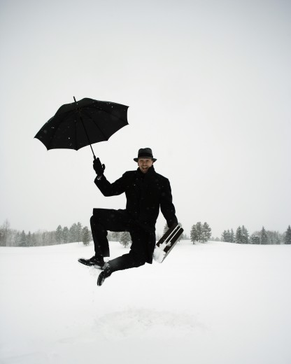 Stock Photo: 1889R-10198 Carefree businessman in the snow