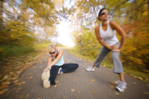 Women stretching for a run : Stock Photo