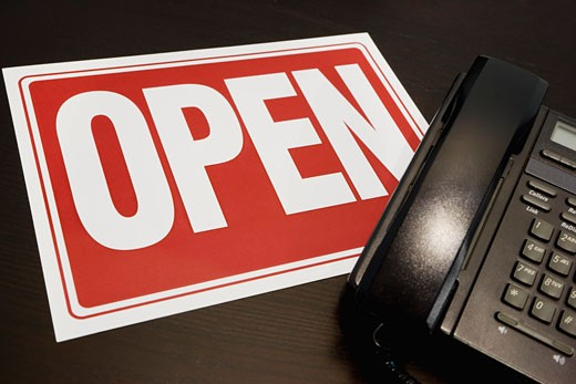 Open sign with a telephone : Stock Photo