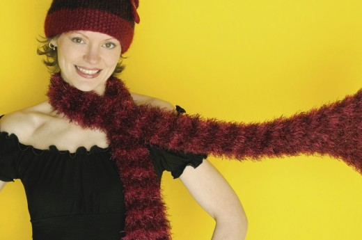 Woman modeling winter hat and scarf : Stock Photo