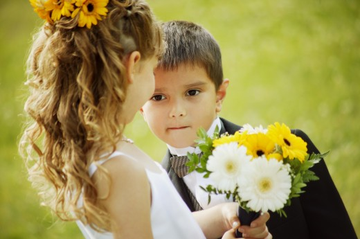 Flower girl and ring bearer : Stock Photo