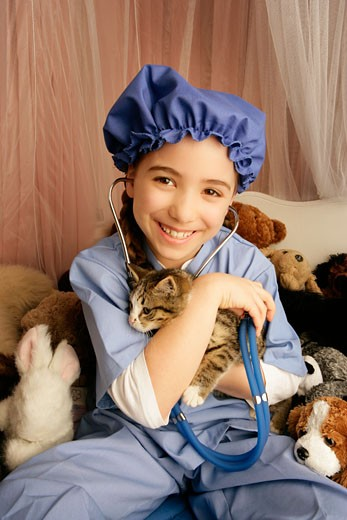 Front view of girl holding cat : Stock Photo
