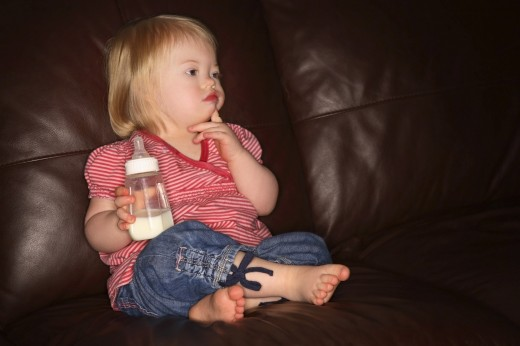 Stock Photo: 1889R-13081 Girl with a bottle