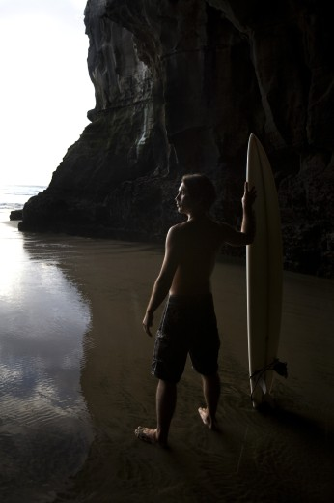Surfer at Muriwai, New Zealand : Stock Photo