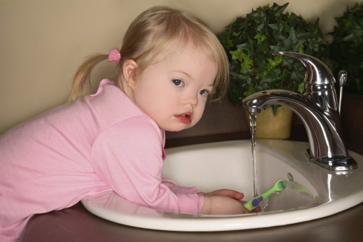 Little Girl Trying To Brush Her Teeth : Stock Photo