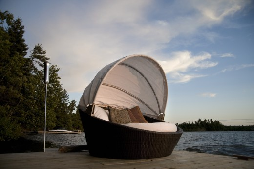Stock Photo: 1889R-13817 Lounging chair on a dock