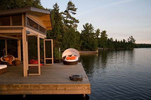 Lake of the Woods, Ontario, Canada; Lounge chairs on dock : Stock Photo
