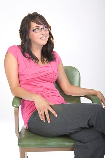 Young woman sitting : Stock Photo