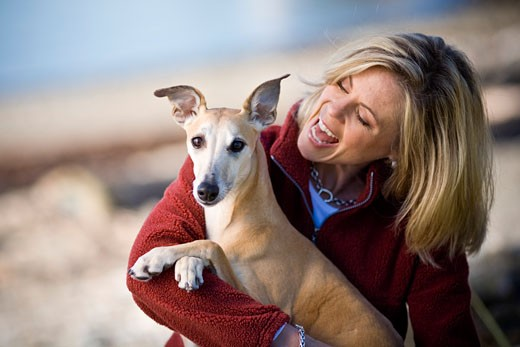 Stock Photo: 1889R-15077 Woman and her dog