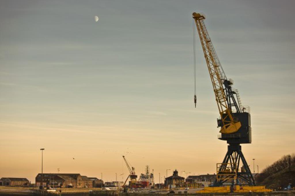 Tyne and Wear, Sunderland, England; Crane and buildings : Stock Photo