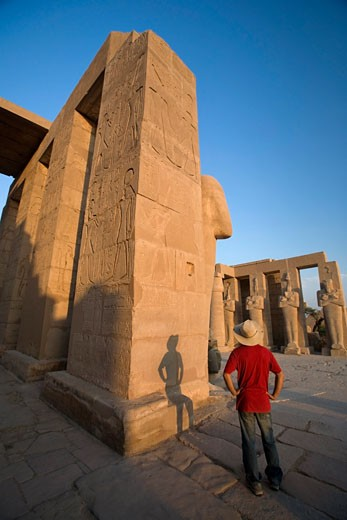 Stock Photo: 1889R-17197 Luxor, Egypt; The Ramesseum, A tourist enjoying the view