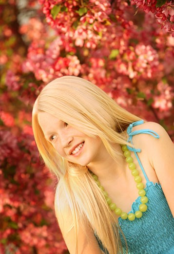 Stock Photo: 1889R-17344 Portrait in spring; Pretty blonde girl outdoors
