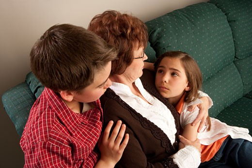 Mother and children; Worried family embrace each other : Stock Photo
