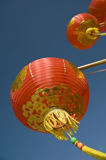 Stock Photo: 1889R-17709 Chinese lanterns; Chinese lanterns against sky