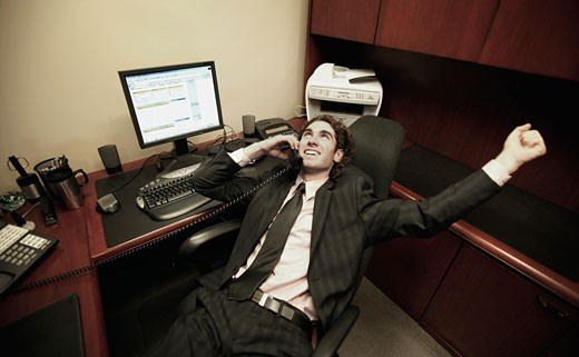 Stock Photo: 1889R-1795 Business Man in office talking on phone