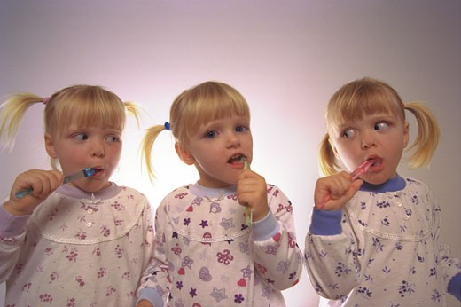 Stock Photo: 1889R-18036 Triplets brushing teeth