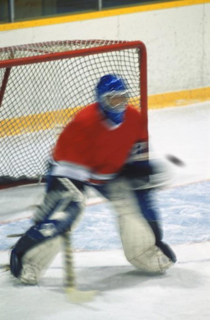Hockey goalie making save : Stock Photo