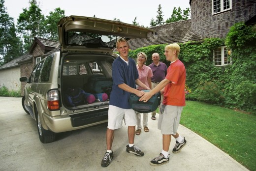 Family packing for camping trip : Stock Photo