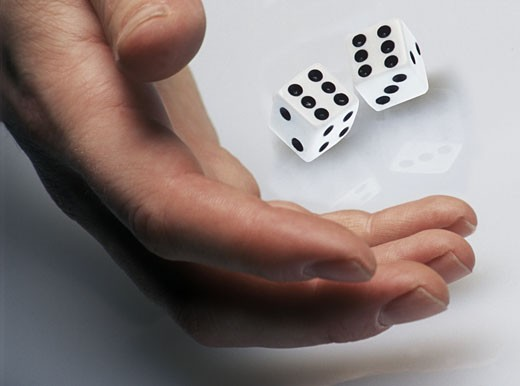 Hand rolling die : Stock Photo