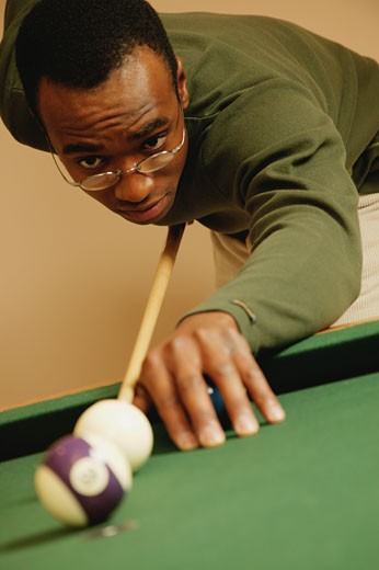 Playing a game of pool : Stock Photo