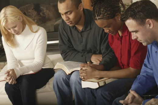 Stock Photo: 1889R-19269 Group Bible study and prayer