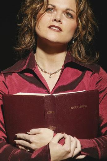 Woman holding Bible : Stock Photo