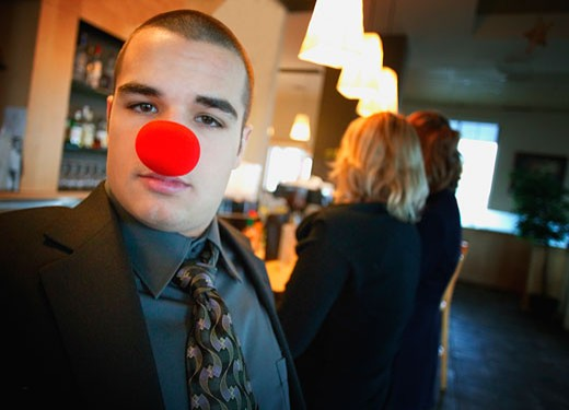 Businessman wearing red nose : Stock Photo