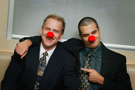 Two Businessmen being silly wearing red noses : Stock Photo