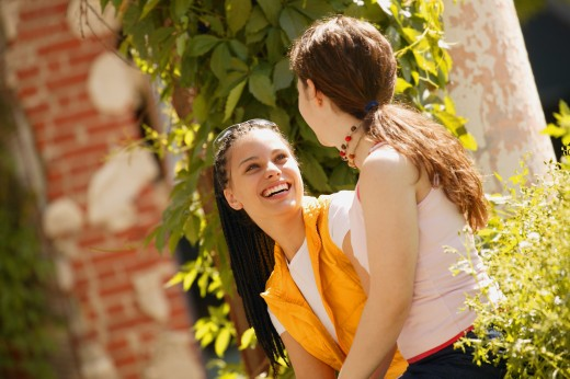 Stock Photo: 1889R-20034 Two girls share a joke