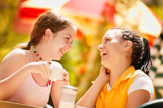 Two girls at a cafe : Stock Photo