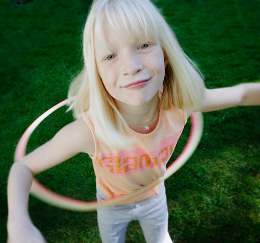 Stock Photo: 1889R-20670 Child plays with hoop