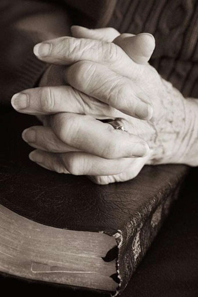 Senior praying with Bible : Stock Photo