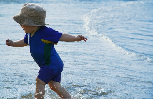Stock Photo: 1889R-21083 Child plays in water