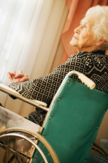 Elderly woman in wheelchair : Stock Photo