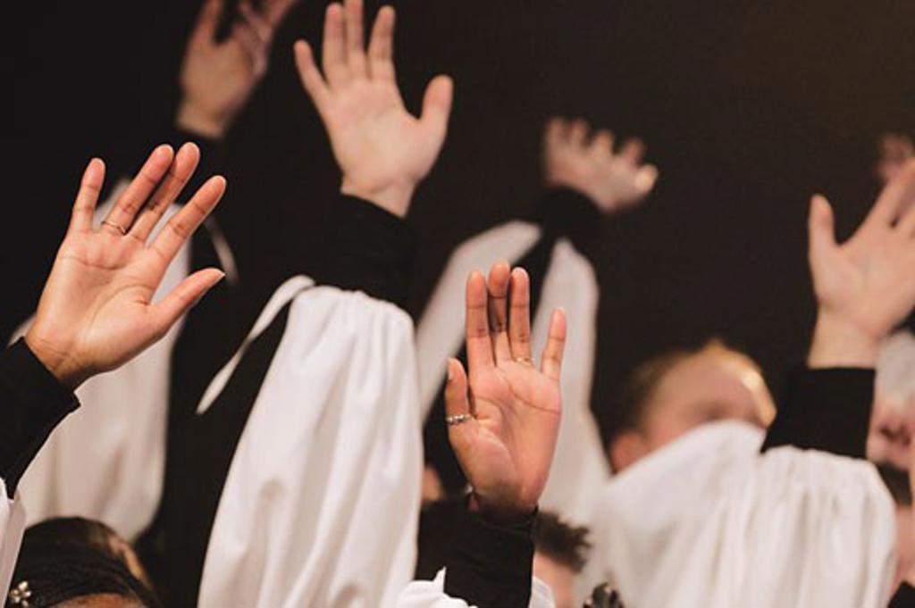 Hands raised in worship : Stock Photo