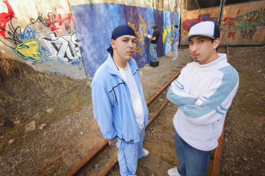 Stock Photo: 1889R-21555 Two men by graffiti