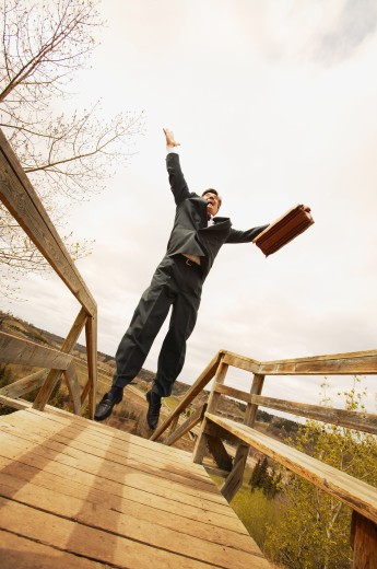 Stock Photo: 1889R-21645 Businessman jumps