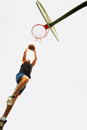 Man playing basketball : Stock Photo