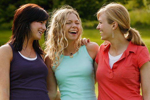 Stock Photo: 1889R-22008 Three women enjoy a laugh