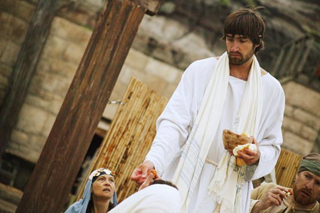 Jesus shares bread : Stock Photo
