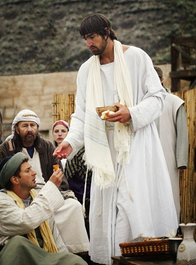 Jesus offers communion : Stock Photo