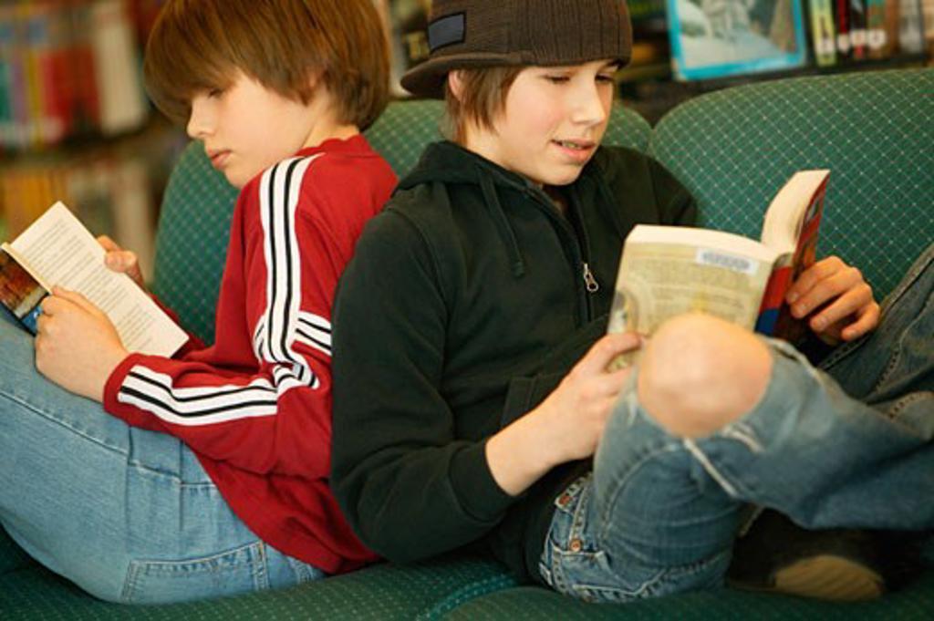 Boys reading books : Stock Photo