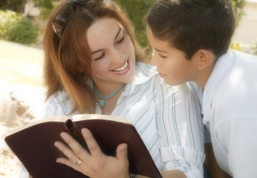 Stock Photo: 1889R-22775 Mother and son reading Bible