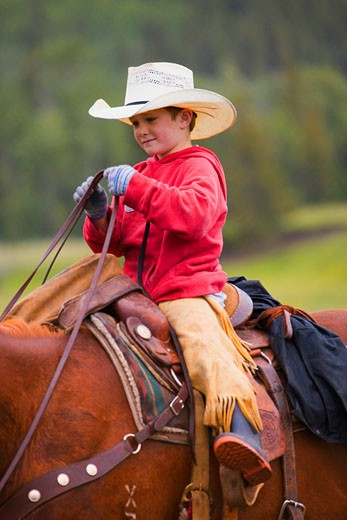 Stock Photo: 1889R-22926 Young cowboy on horse