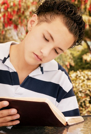 Stock Photo: 1889R-23345 Child reads Bible