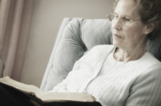 Elderly lady reading : Stock Photo
