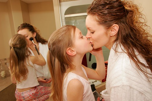 Mother and daughter getting dressed up : Stock Photo